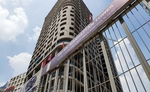 Real estate Landmark Holding shares dive on delisting decision