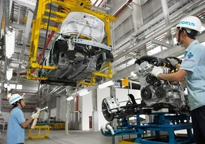Industrial output rises slightly