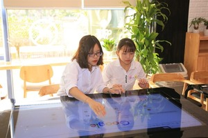 Smart screen table launched at National Economics Unversity