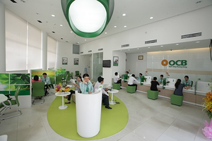 Vietcombank sells out OCB stake at auction