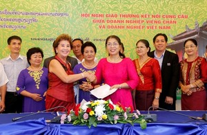 Vientiane conference links VN, Lao firms