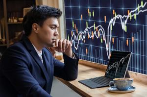 Shares volatile as large caps slump