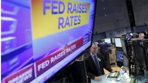 US Fed raises benchmark interest rate amid strong economy