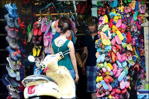 Plastic shoe sales soar during rainy season in HCM City