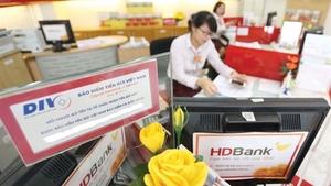 VN, Laos tighten ties in deposit insurance