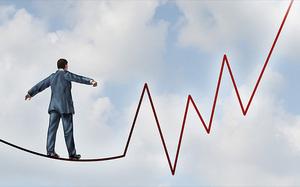 Shares volatile as large caps drop