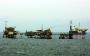 Selling, oil prices take down local stocks