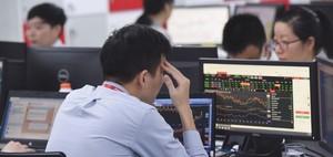 Shares struggle as large-caps vary