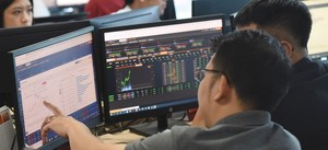 Securities sector pushes shares up