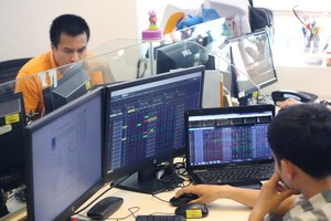 Shares mixed in morning session