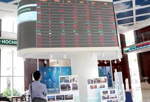Shares trim losses on late buying force